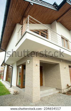 Front of contemporary and beauty detached house - stock photo