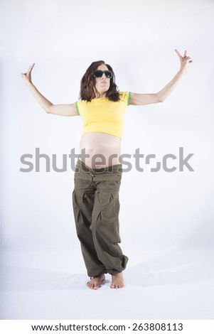 front of naked paunch eight month pregnant woman with brazilian colors shirt celebrating success winner isolated on over white background - stock photo