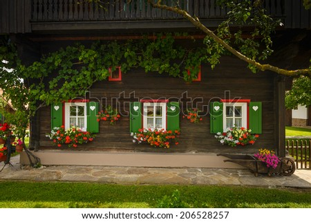 Front of old wooden house with green shutters,Styria,Austria. - stock photo