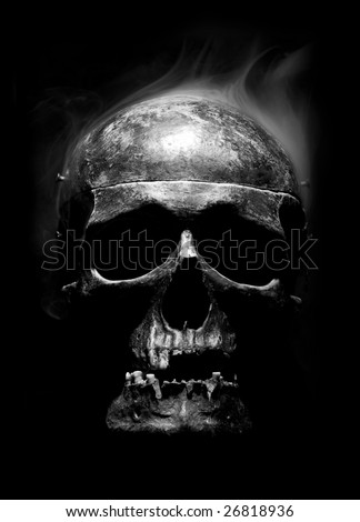 front of real skull with smoke like a hear - stock photo