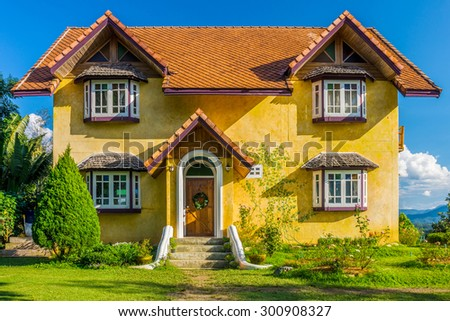Front of vintage yellow European style house in countryside of Mae Hong Son province, Northern Thailand - stock photo
