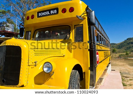 Front of Yellow School Bus with Blue Sky - stock photo