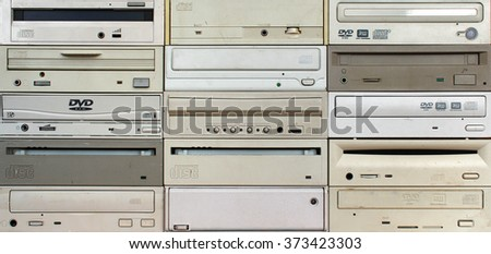 Front panels of old cd and dvd drives as background - stock photo