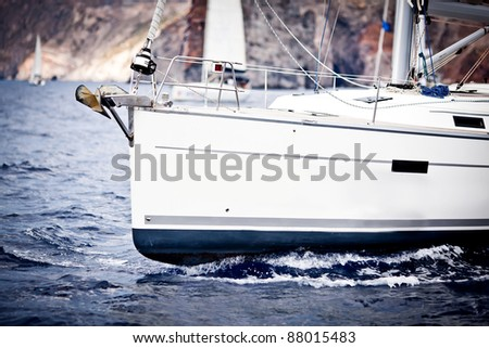 Front part of the yacht at open sea - stock photo