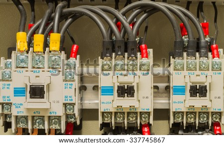 Front side showing switches and wiring of machine control - stock photo