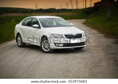 Front-side view of a car on nature background - stock photo