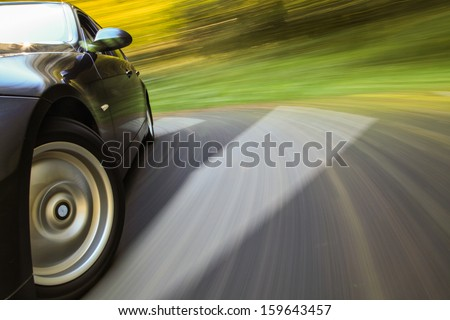 Front side view of black sedan in turn. - stock photo