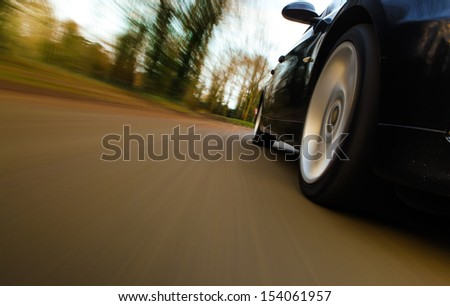 Front side view of speeding car. - stock photo