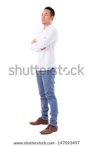 Front view full body confident serious Asian man looking at side standing isolated on white background. Asian male model. - stock photo
