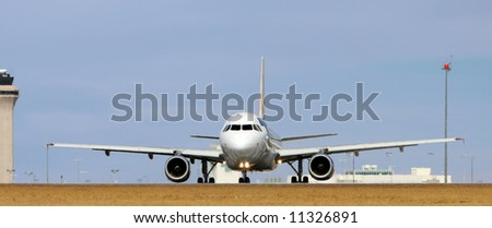 front view - large plane on the runway - stock photo