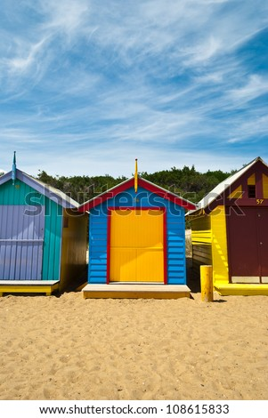 Front view of a couple of beach huts closed - stock photo