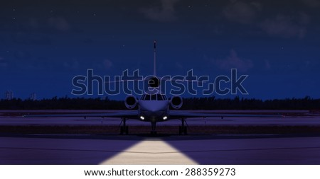 Front view of a private jet on the runway at night  - stock photo