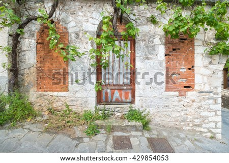 Front view of a traditional Greek house. - stock photo