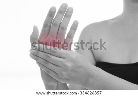 Front view of a young women hand muscle pain. Red around the pain area. - stock photo