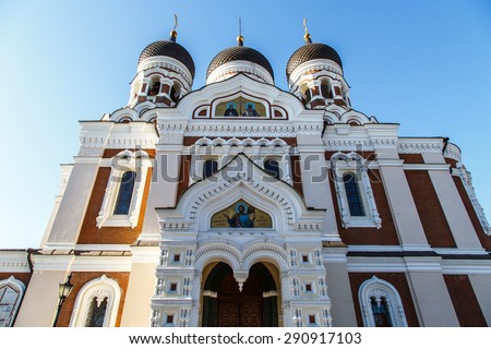 Front view of Alexander Nevsky Cathedral with three domes built in Tallinn Estonia in 1900, on blue sky background. - stock photo