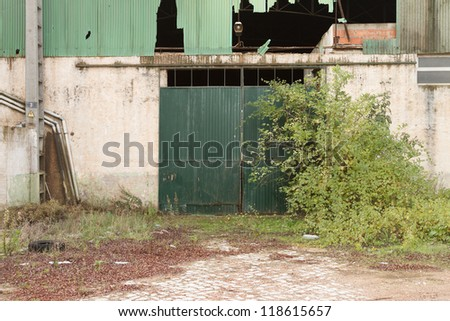 Front view of an closed rusty warehouse - stock photo