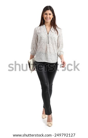Front view of an elegant woman walking isolated on a white background - stock photo