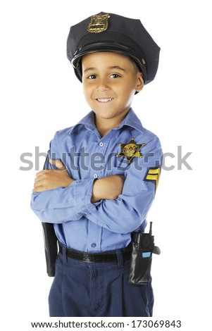 """Front view of an elementary """"policeman"""" smiling at the viewer with his arms folded.  On a white background. - stock photo"""