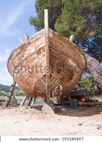 Front view of an old wooden fishing boat being restored - stock photo