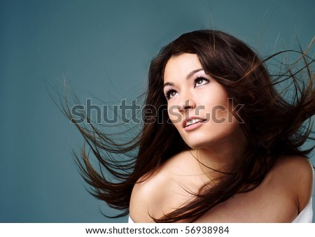Front view of beauty and sexy woman with blown hairs - stock photo