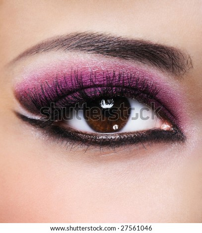 Front view of beauty female eye with purple make-up - stock photo