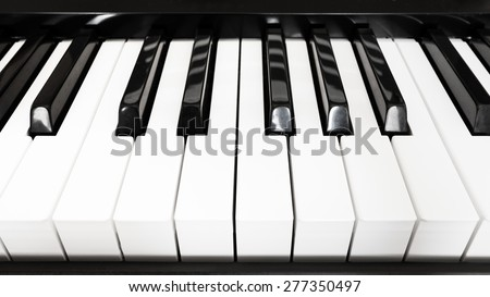 front view of black and white keyboard of digital piano close up - stock photo