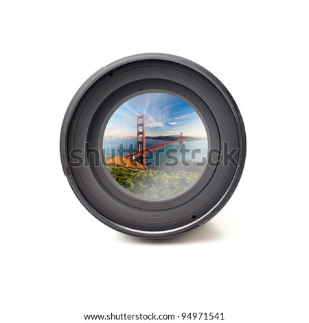 Front view of camera lens with Golden Gate bridge image reflection - stock photo