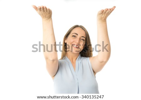 Front view of caucasian woman with arms raised supporting something - stock photo