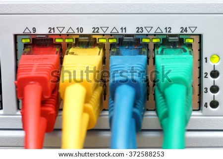 front view of colorful cables connected in high speed switch - stock photo