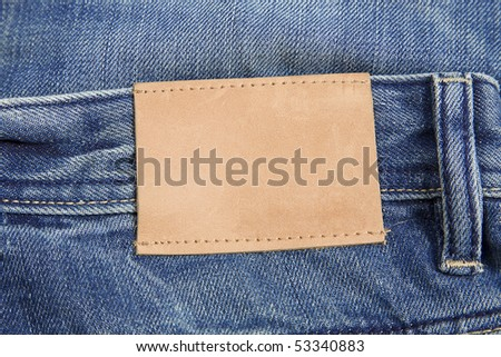 front view of denim label, blue jeans and leather label - stock photo