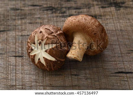 Front view of fresh Shiitake, edible mushroom Mushroom isolated on wooden background - stock photo