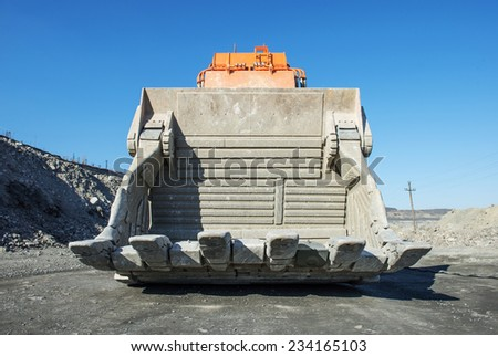 Front view of giant excavator's scoop stands in iron ore mine, Ukraine - stock photo