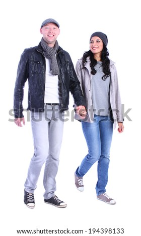 Front view of going young couple (man and woman) . walking girl and guy in jacket and jeans together. Isolated over white background. - stock photo