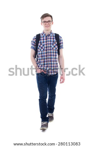 front view of handsome teenage boy with backpack walking isolated on white background - stock photo