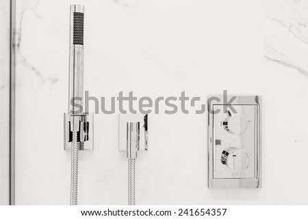 Front view of Modern luxury bathroom fixtures and fittings - stock photo