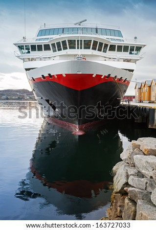 Front view of moored big modern passenger cruise ship - stock photo