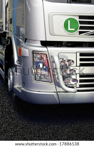 Front view of new silver cargo truck - stock photo