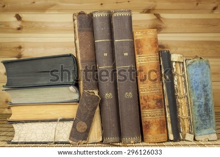 Front view of old books lined up. Studying the history of old books. - stock photo