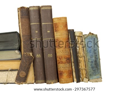 Front view of old books stacked on a shelf. Books without title and author. Isolated on white background, place for your text - stock photo