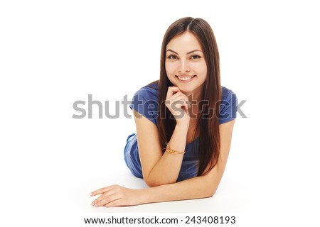 Front view of smiling beautiful woman lying on the floor over white background and looking at camera - stock photo
