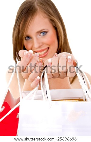 front view of smiling female showing carrybags on an isolated white background - stock photo