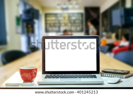 Front view of the laptop and coffee cup is on the work table in meeting room.  - stock photo