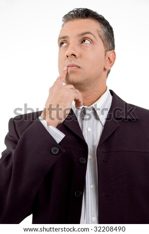 front view of thinking adult businessman looking aside on white background - stock photo