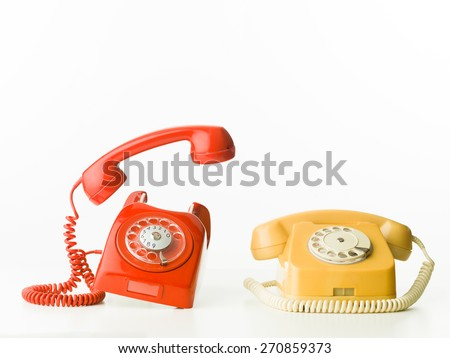 front view of two vintage phones ringing, isolated on white background - stock photo