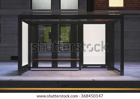 Front view on blank posters on the wall of bus stop on night city street, mock up 3D Render - stock photo
