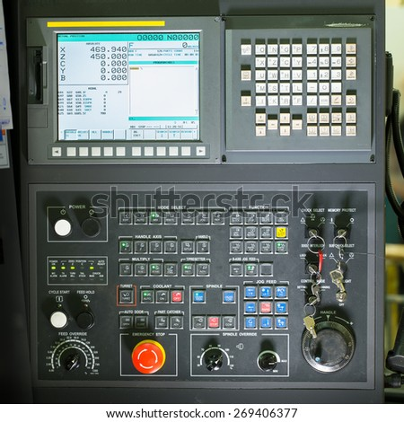 Front view on cnc milling machine control panel with display - stock photo