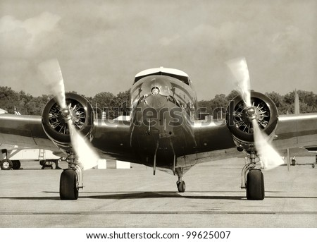 Front view vintage propeller airplane running engines - stock photo