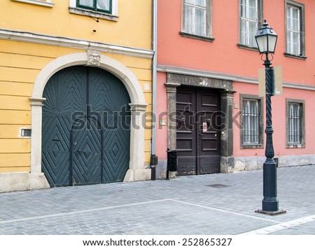 Front wall of old tenement house - stock photo
