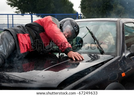 Frontal hit between a car and a motorbike - stock photo