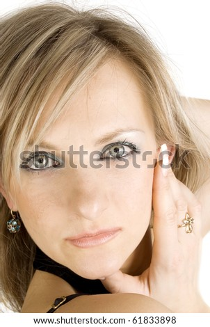 Frontal portrait of a caucasian serious woman  with gray eyes isolated on the white. - stock photo
